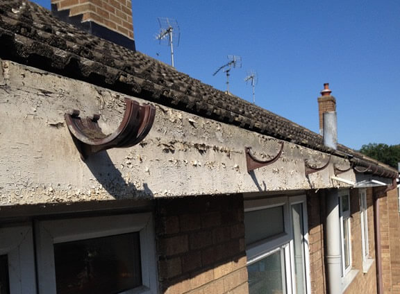 Take down existing gutters and strip off old wooden fascias